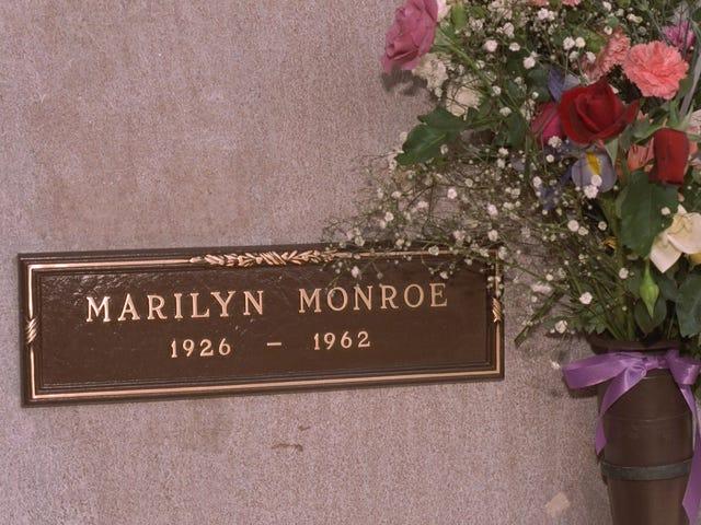 Even in Death, Hugh Hefner Sleazily Sidles Up to Marilyn Monroe