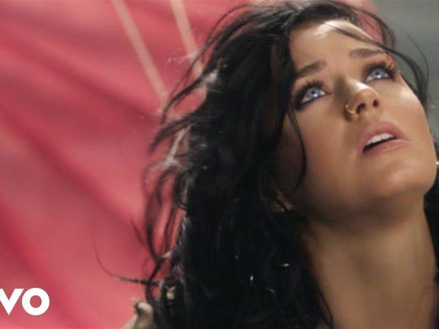 Посмотрите, как Кэти Перри часто падает в видео для ее олимпийского гимна «Восстание»