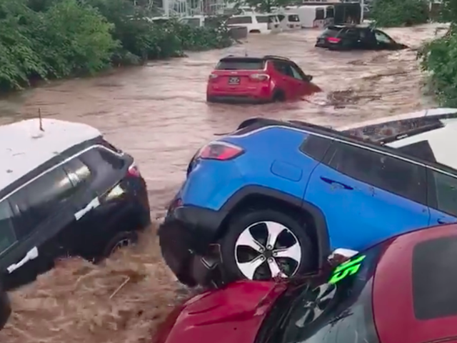 Watch a New Jersey Dealership's Jeeps and Rams Get Swept Away by a Raging Flood