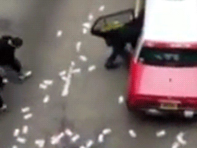 Chaos ensues as armored truck spills $4.5 million on a street