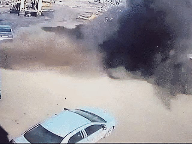 Car Crushed After Russians Forgot They Were Pumping Up A Massive Three-Ton Tire