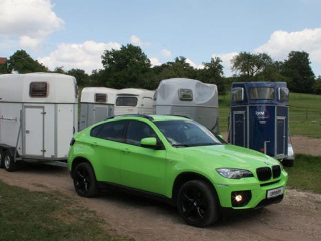 BMW caught doing 213 kph in a 80 kph ... with a trailer.