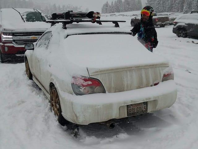 Snow on my very dirty car in Montana