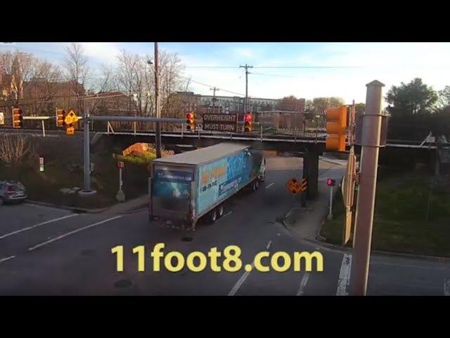Speeding Semi crashes into 11Foot8 bridge.