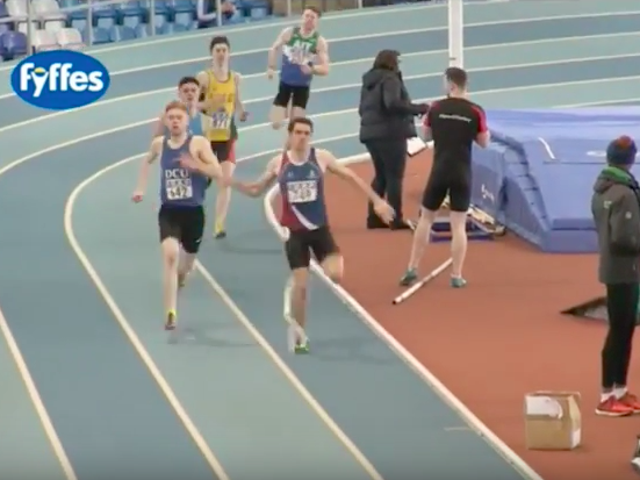 Runner Foiled By Pole Vaulter's Giant Rubber Band
