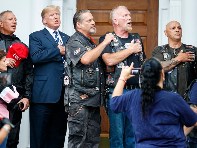 Snopes Debunks Claim That Trump Posed With Bikers With Nazi Tattoos on Charlottesville Anniversary [Corrected]