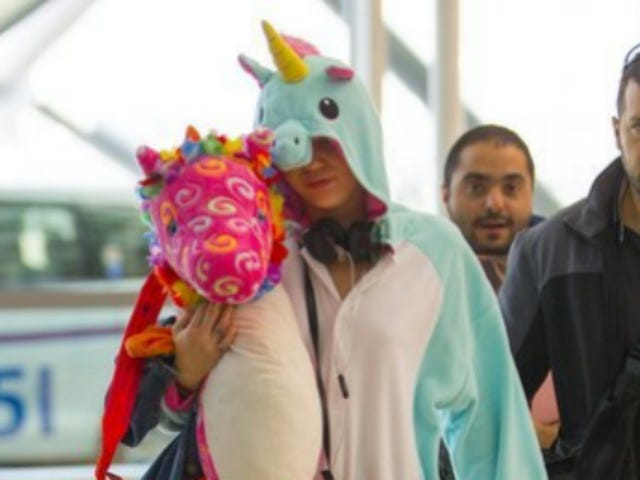 Miley Cyrus Flew To Australia In A Unicorn Onesie