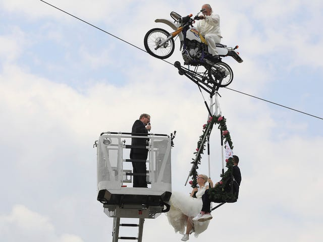 Saturday Night Social: Congrats to This Couple Who Wedded on a Swing Hanging from a Motorcycle on a Tightrope!