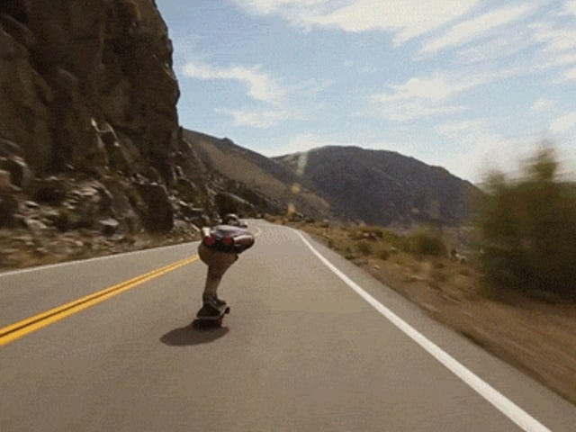 Skateboarder zips down mountains and flies by cars at insane speeds
