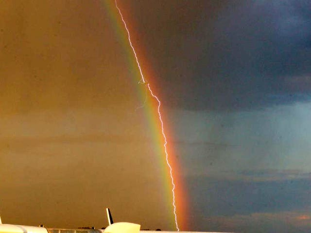 Amazing photo shows lightning striking an airliner flying in a rainbow