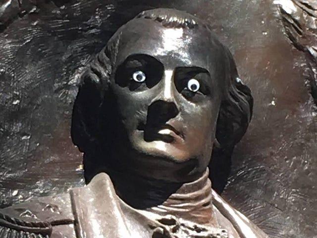 A cool vandal stuck googly eyes on a statue