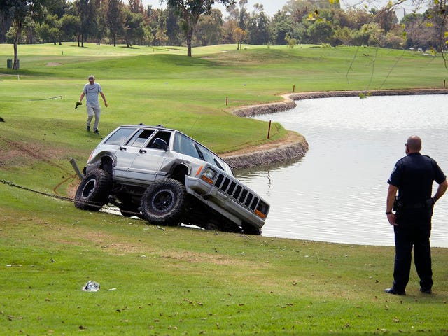 Shitty Driver and Jeep Thief Crashes Into Water Hazard, Gets Tackled By Golfer