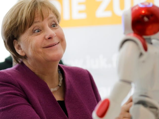 German Leader Angela Merkel Still Way Too Friendly With Robots