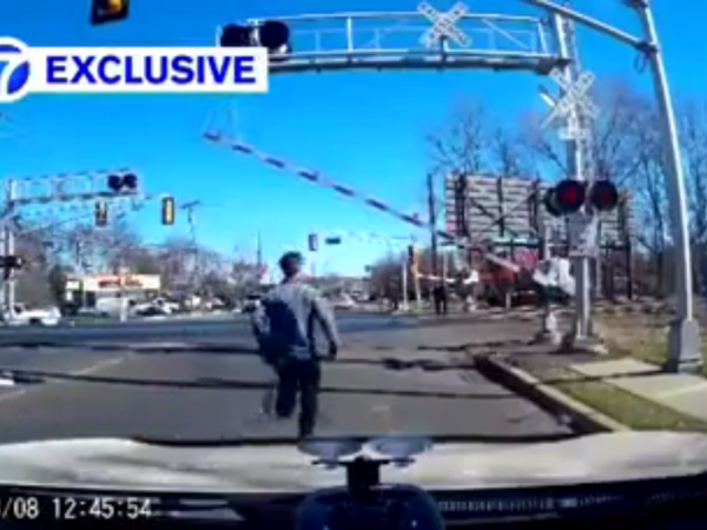 Watch This Man Save An Elderly Woman From Being Hit By A Train
