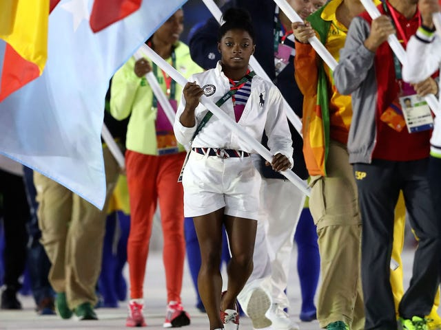 Simone Biles, Queen of the Olympics, Bears the US Flag In Closing Ceremonies