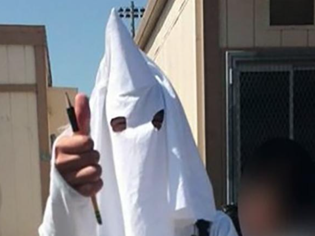 White Kid Wears KKK Costume to School as an Assignment ... With Teacher's Approval