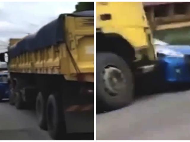 Piccole grida di berline per la vita cara come camion ribaltabile spinge centinaia di iarde lungo la strada