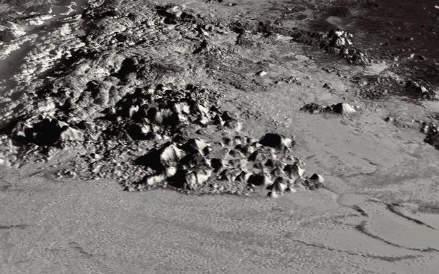 Estos nuevos mapas de Plutón y su luna Caronte son los más detallados hasta ahora