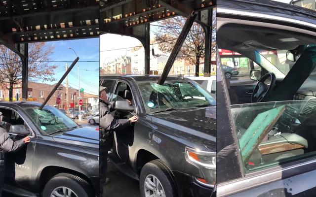 高架地下鉄の巨大な塊が移動中の車のフロントガラスを突き破る