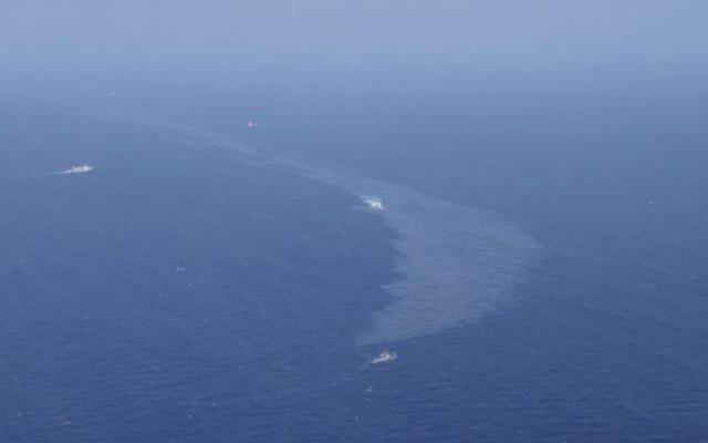 जापानी समुद्र तटों पर तेल पिछले महीने के सांची टैंकर फैल से जुड़ा हुआ है
