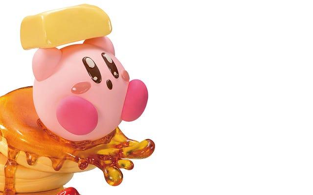 Aquí está Kirby en panqueques blandiendo una barra de mantequilla