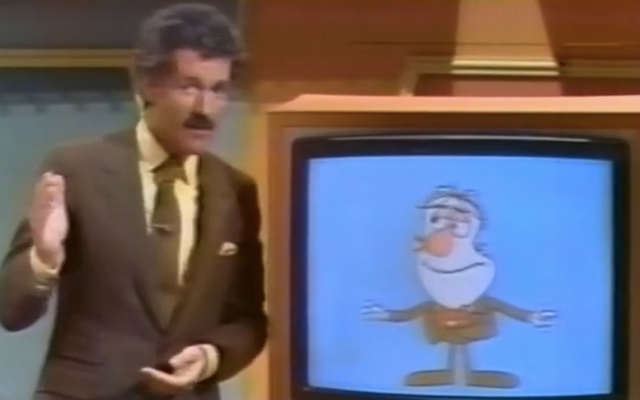 ดูนักบินที่ไม่มีคู่ของเกมโชว์แปลกประหลาด Alex Trebek ซึ่งจัดแสดงด้วยหุ่นดิจิทัลชื่อ Malcolm