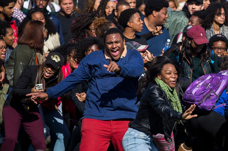 Members of Concerned Student 1950 celebrate after the resignation of Missouri University President Timothy M. Wolfe on the Missouri University Campus Nov. 9, 2015, in Columbia, Mo. (Brian Davidson/Getty Images)