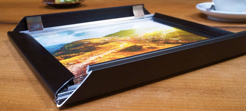 Illustration for article titled A Clever Front-Loading Picture Frame Makes Swapping Artwork Easy