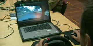 Illustration for article titled Army Simulator Is Short On Graphics, Big On Steering Wheel Peripherals
