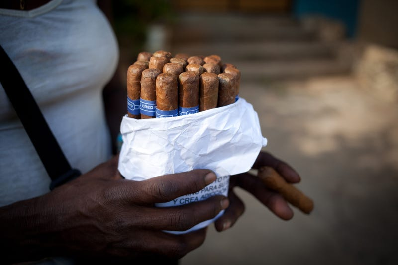 A woman sells cigars on the street in Havana on Dec. 20, 2014.Lisette Poole/Bloomberg via Getty Images