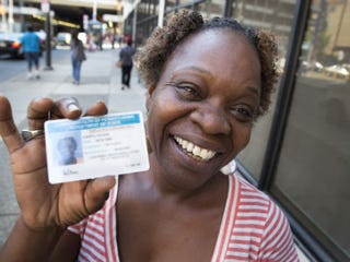 Philadelphian Ann Moore with her new ID (Washington Post)