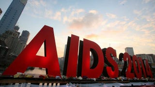 Signage for the 20th International AIDS Conference is seen on the Princes Bridge prior to a candlelight vigil at Federation Square on July 22, 2014, in Melbourne, AustraliaGraham Denholm/Getty Images