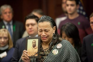 Miyoshia Bailey cries as she describes how her only son, Cortez Bailey, 23, was shot to death in Chicago during a press conference featuring supporters of gun control and family members of gun-violence victims on Capitol Hill in Washington, D.C., on Dec. 10, 2015.Allison Shelley/Getty Images