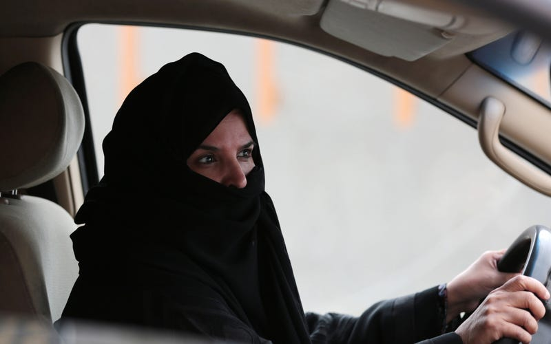 Aziza Yousef drives a car on a highway in Riyadh in 2014, as part of a campaign to defy Saudi Arabia's ban on women driving. Image: AP