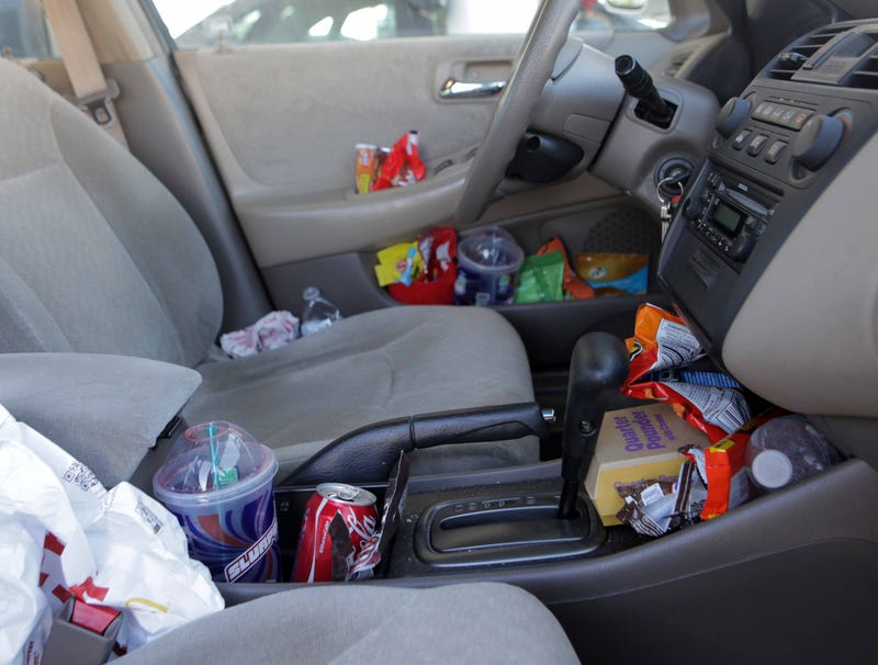 Illustration for article titled Every Conceivable Nook In Car Stuffed With Trash By Second Hour Of Road Trip