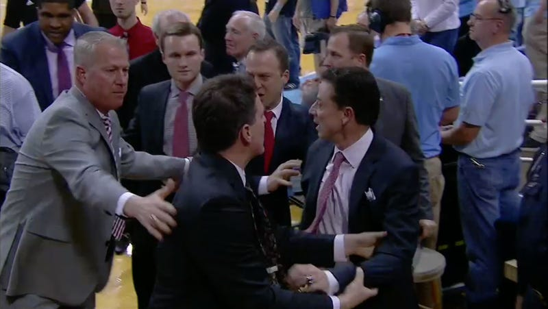 Illustration for article titled Pissed Off Rick Pitino Blows His Top At Fan, Has To Be Restrained By Coaching Staff [Update]