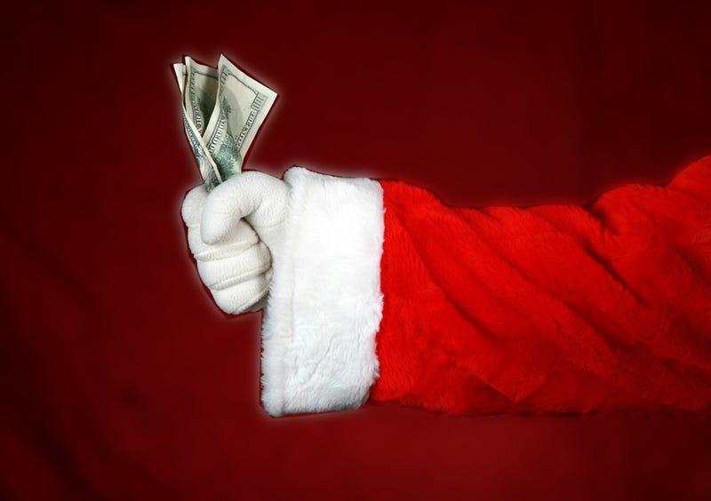 Illustration for article titled Secret Santas Handing Out Cash