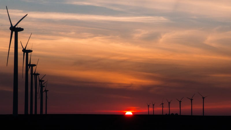 Sunset on a wind farm in Blairsburg, Iowa.
