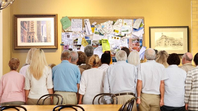 Onlookers scramble to get a look at the freshly updated bulletin board.