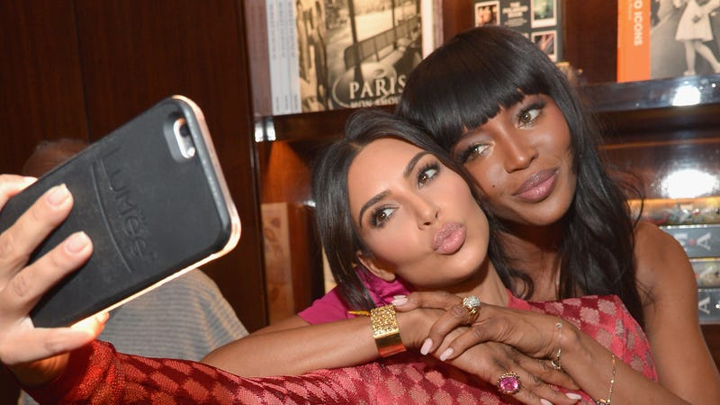 Kim Kardashian and Naomi Campbell take a selfie during the Los Angeles launch of 'Naomi'  on April 28, 2016 in Beverly Hills, California.