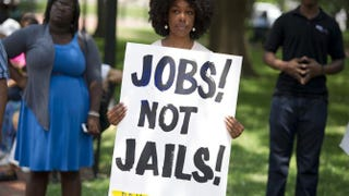 A demonstrator at a rally after a protest march calling on President Barack Obama to end the war on drugs, and calling for additional investment in jobs in urban neighborhoods, during a Day of Direct Action event in Lafayette Park in Washington, D.C., on June 17, 2013SAUL LOEB/AFP/Getty Images