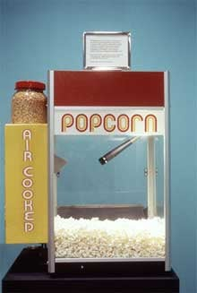 Illustration for article titled Talking Popcorn Machine Translates Pops Into Words