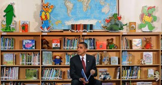President Barack Obama reads from his book Of Thee I Sing to second-graders at Long Branch Elementary School in Arlington, Va., Dec. 17, 2010.Olivier Douliery-Pool/Getty Images