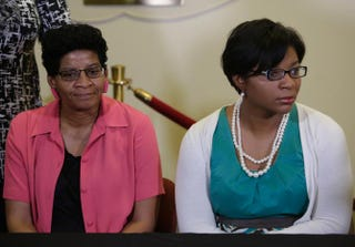 The mother of Sandra Bland, Geneva Reed-Veal, and sister Sharon Cooper attend a news conference at DuPage African Methodist Episcopal Church July 22, 2015, in Lisle, Ill., July 21, 2015.Joshua Lott/Getty Images