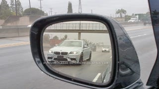 Illustration for article titled 2012 BMW M5 plows through the rain