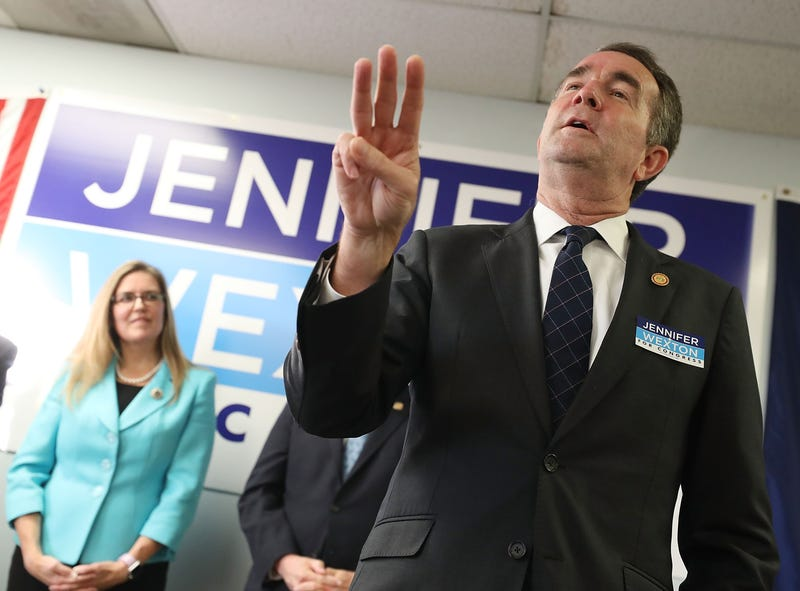 Virginia Governor Ralph Northam (D) speaks while flanked by Virginia State Senator and candidate for the U.S. House of Representatives Jennifer Wexton (D) during a rally at the Wexton campaign headquarters on October 30, 2018 in Sterling, Virginia.
