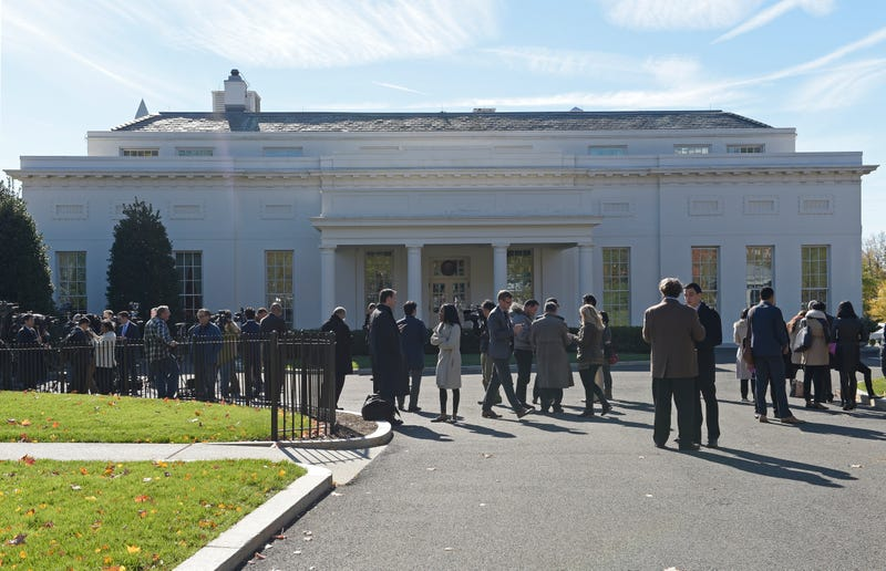 Reporters waiting for Donald Trump outside the West Wing. Photo: AP