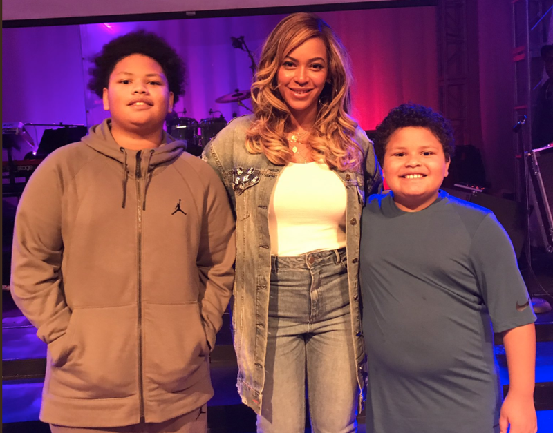 The Root associate editor Kirsten West Savali's sons Walker and Dash with Beyoncé (@KWestSavali via Twitter screenshot)