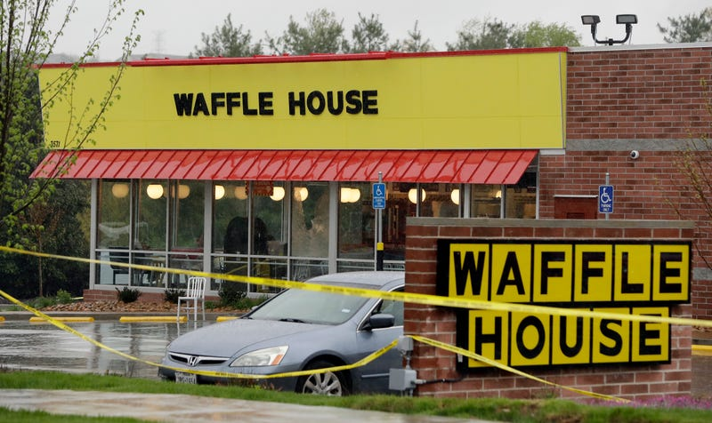 Police tape blocks off a Waffle House in Antioch, Tenn., outside Nashville on April 22, 2018, where four people died after a gunman opened fire at the restaurant.
