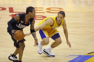 Allen Iverson of the Philadelphia 76ers (left) drives against Tyronn Lue of the Los Angeles Lakers in Game 2 of the NBA Finals on June 8, 2001, in Los Angeles.Jeff Gross/Allsport